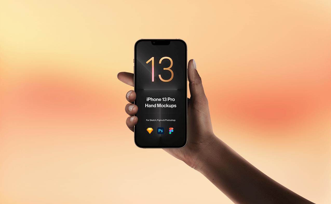 Free Hand holding iPhone 13 Pro Mockup