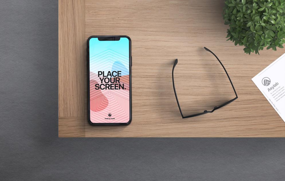 Iphone X On Desk Mockup Psd Apemockups