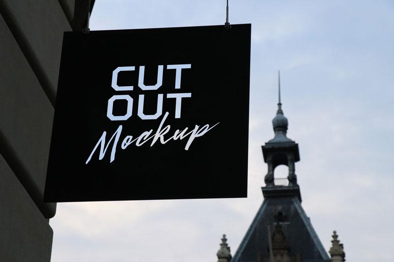 free outdoor advertising wall hanging shop sign board mockup psd