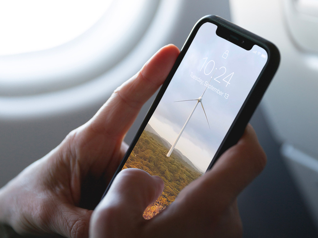 Free iPhone XS on a Plane Mockup