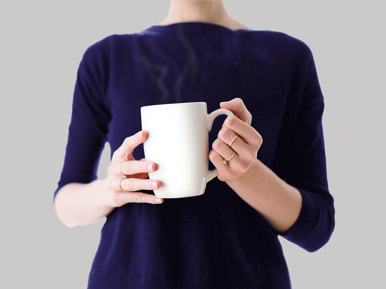 Woman holding Coffee Mug Mockup